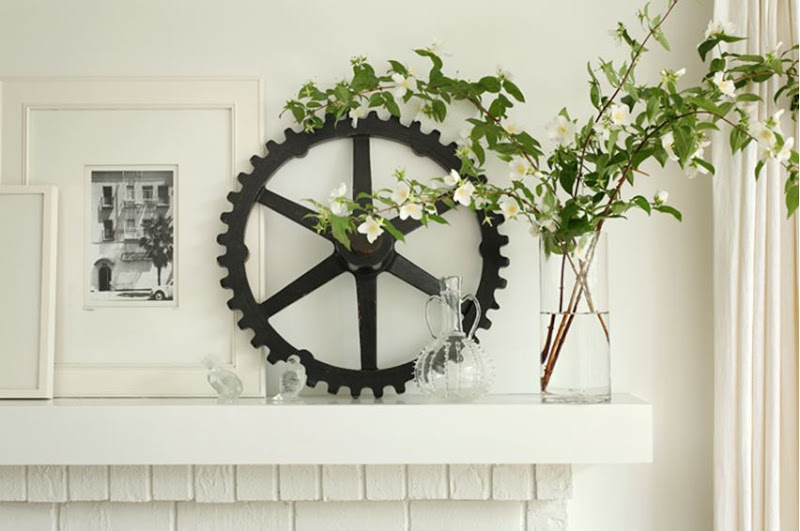 Close up of the black gear and flower arragement on the fireplace mantel