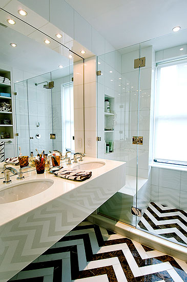 Bathroom with black and white chevron patterned tile floor