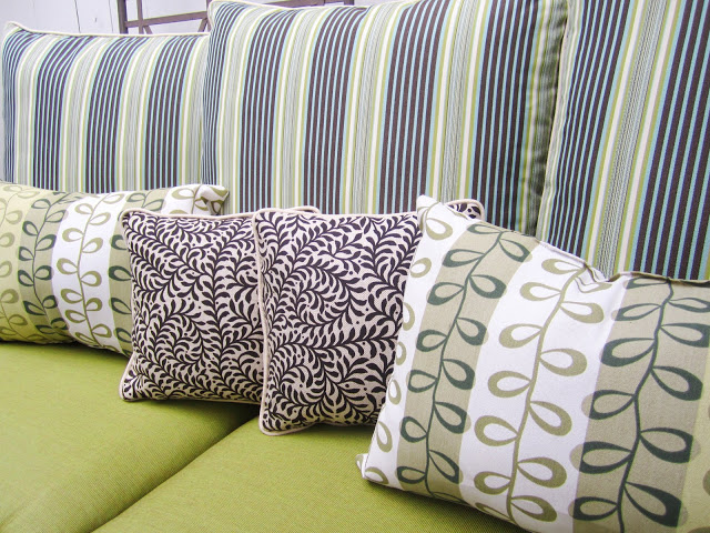 Outdoor accent pillows in a mix of playful prints