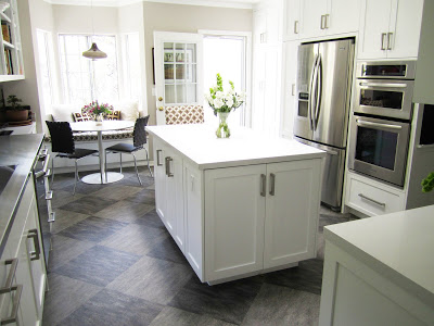 Open and airy kitchen with a center island and a breakfast nook