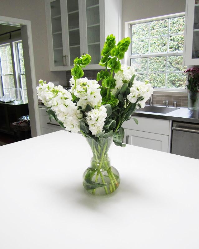 Flower arrangement on a white kitchen island