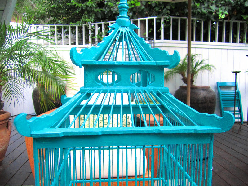 Top of a custom painted teal Chinoiserie inspired wood bird cage