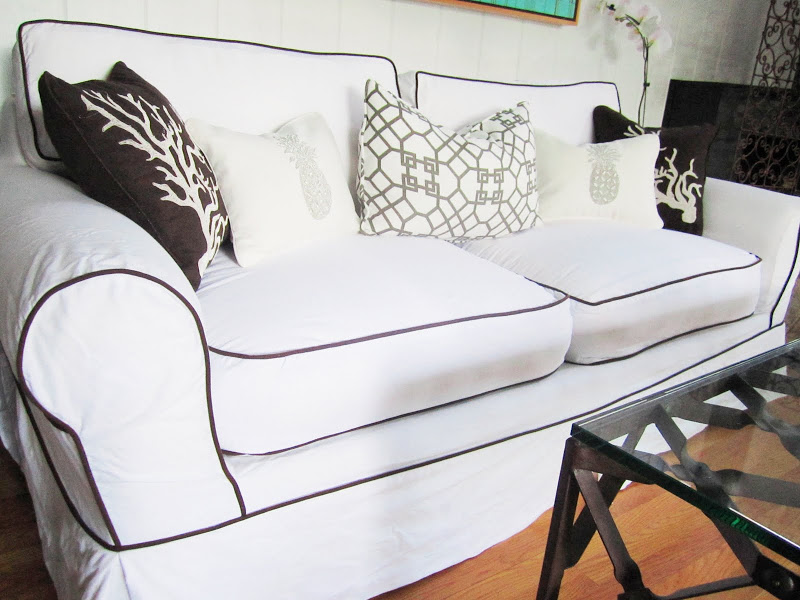 White living room sofa with chocolate piping