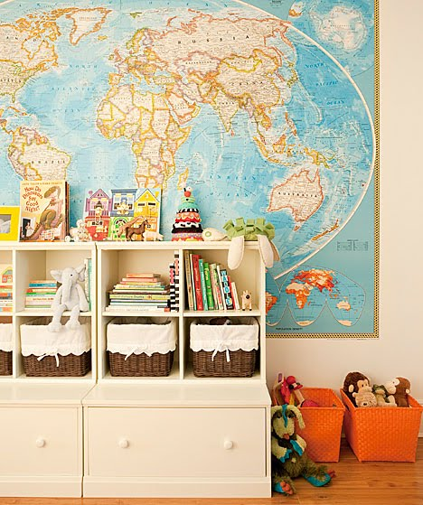 Children's room with a large map of the world and brown and orange wicker storage baskets