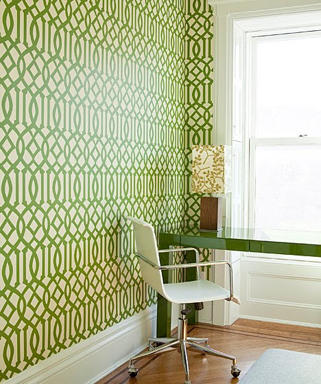 Home office with green and white Kell Wearstler Imperial Trellis wallpaper and a green Parsons desk