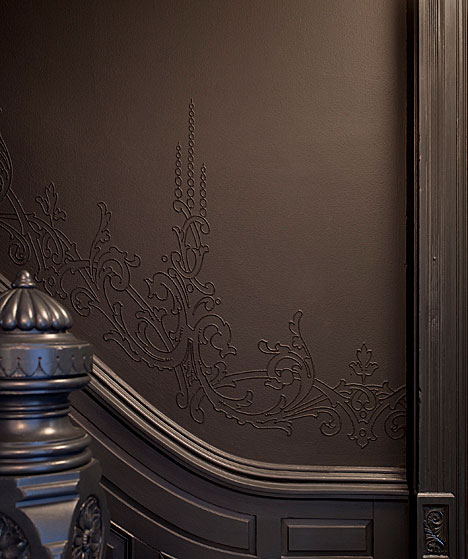 Restored and repainted cake molding in a hallway and stairwell