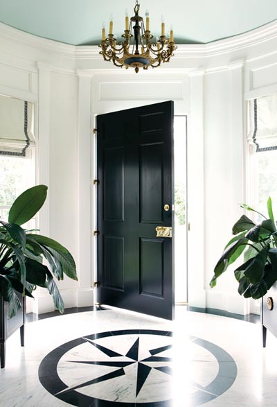 foyer with high gloss black front door, marble inlay floor, Greek key trim roman shades and a Benjamin Moore Palladium Blue ceiling