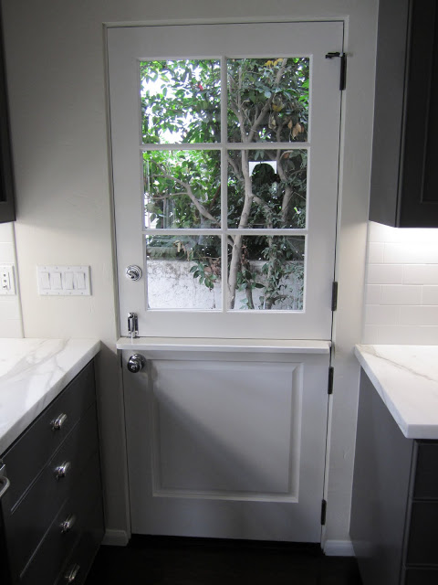 White dutch side door with paned window in a grey kitchen