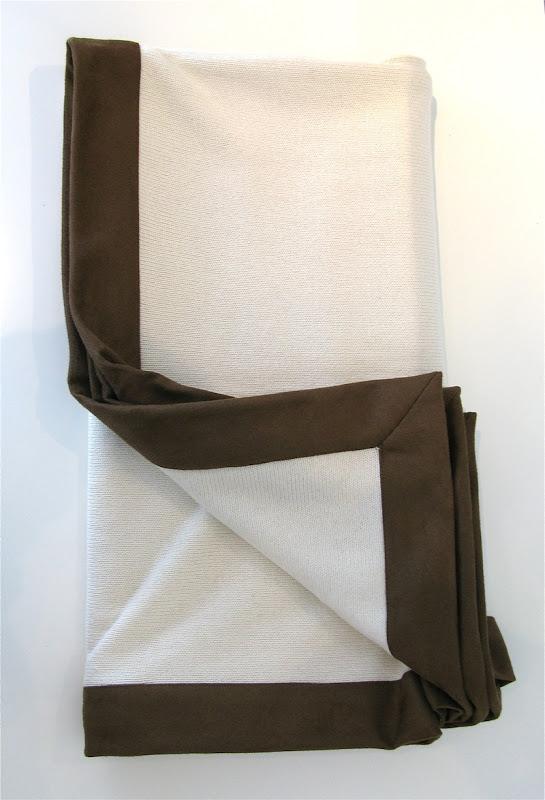 Ivory colored cashmere, silk, cotton blend throw with chocolate brown suede border from Pieces Inc.