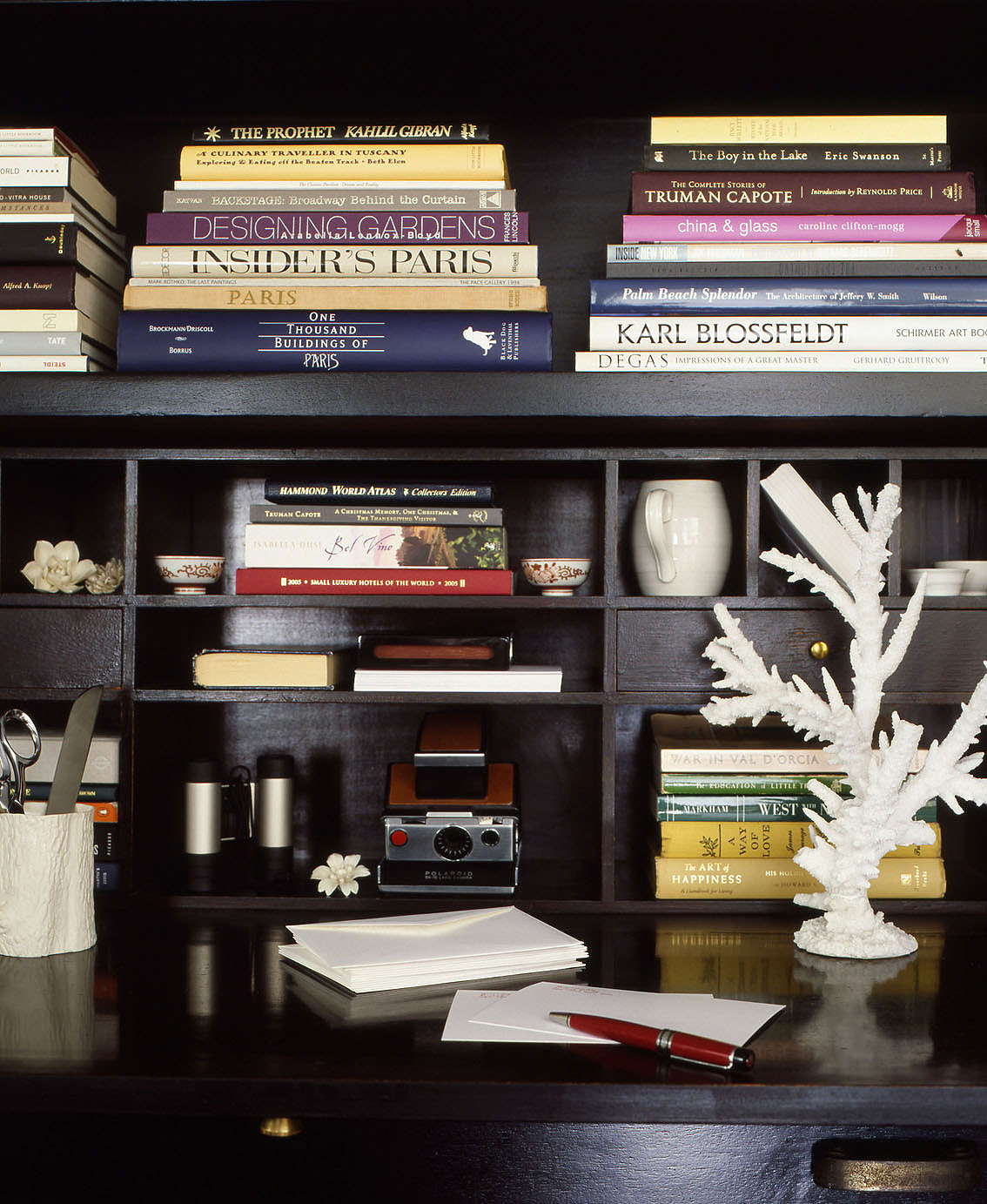 dark wood writing desk with shelves full of books and trinkets black white home office cococozy 5