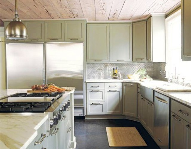 Kitchen with raw wood plank ceiling, nickle pendant light, grey cabinets and drawers, stainless appliances, marble counter tops and subway tile backsplash