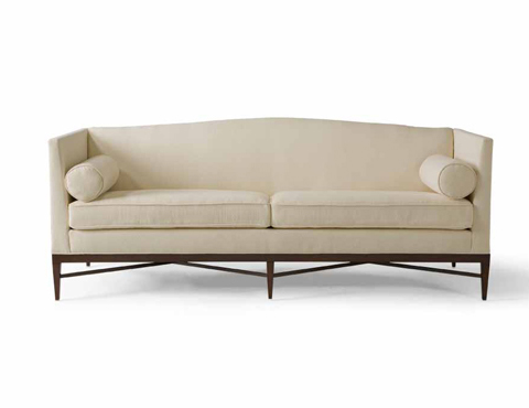 Cream sofa from Bolier & Company with high arms, slightly curved back and exposed wood legs