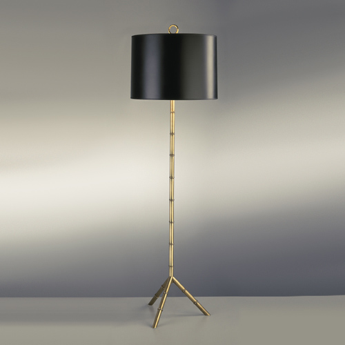 Metal floor lamp with bamboo detail and a tripod base and a black shade by Jonathan Adler from Croft & Little