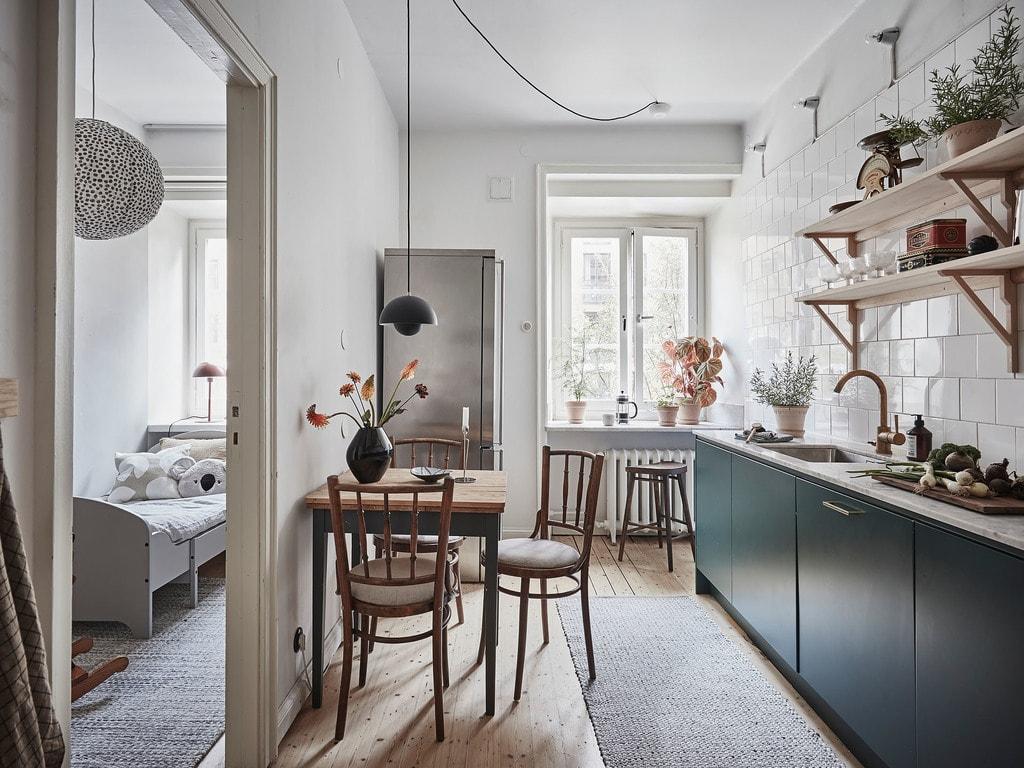 Cozy kitchen in petrol green