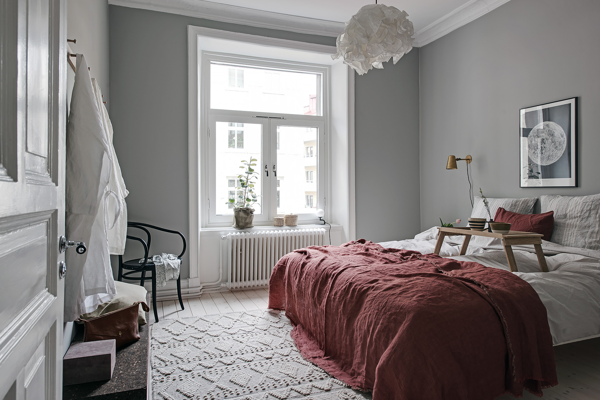 cozy bedroom with red details coco lapine designcoco 15042 | med3939286fc3d24a5385cea010c1c1630d
