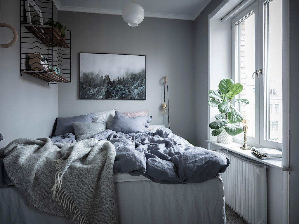 Doesnt this bedroom look absolutely dreamy the tint of grey that is used combined with the foggy forest print and the patchy antique doors combine so