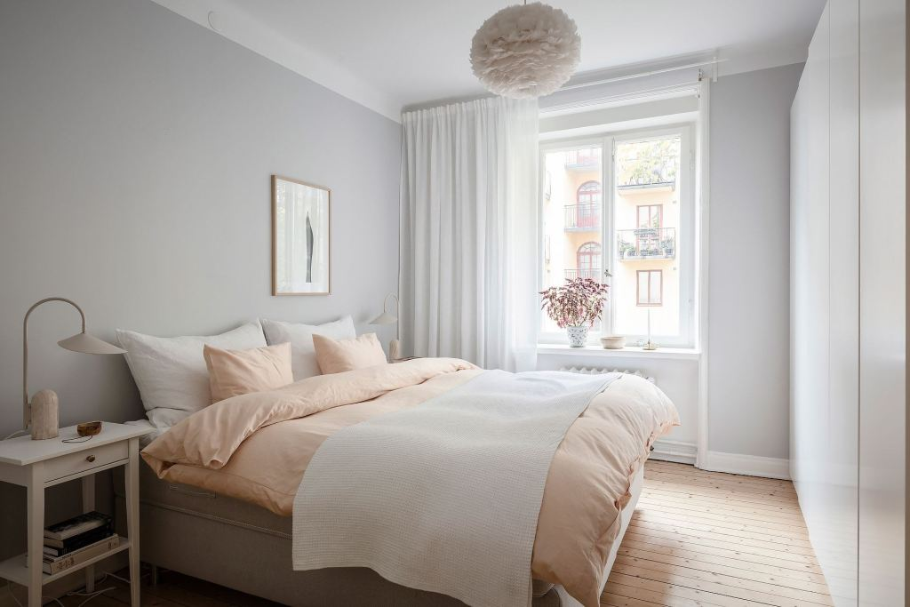 Bright bedroom with a touch of peach