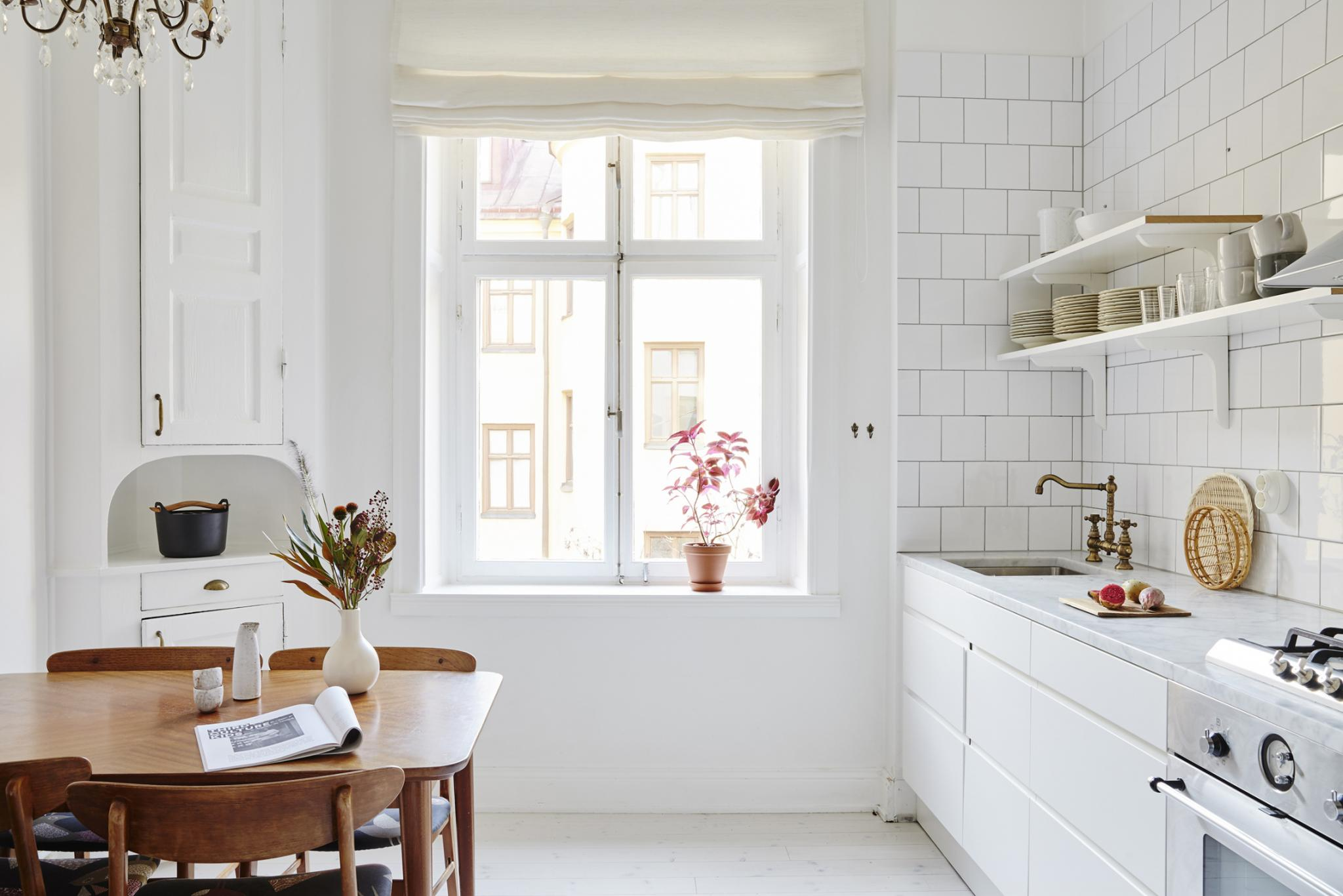I like this white and bright kitchen with vintage elements the original vintage cupboard in white is such a nice element which is perfectly matched with