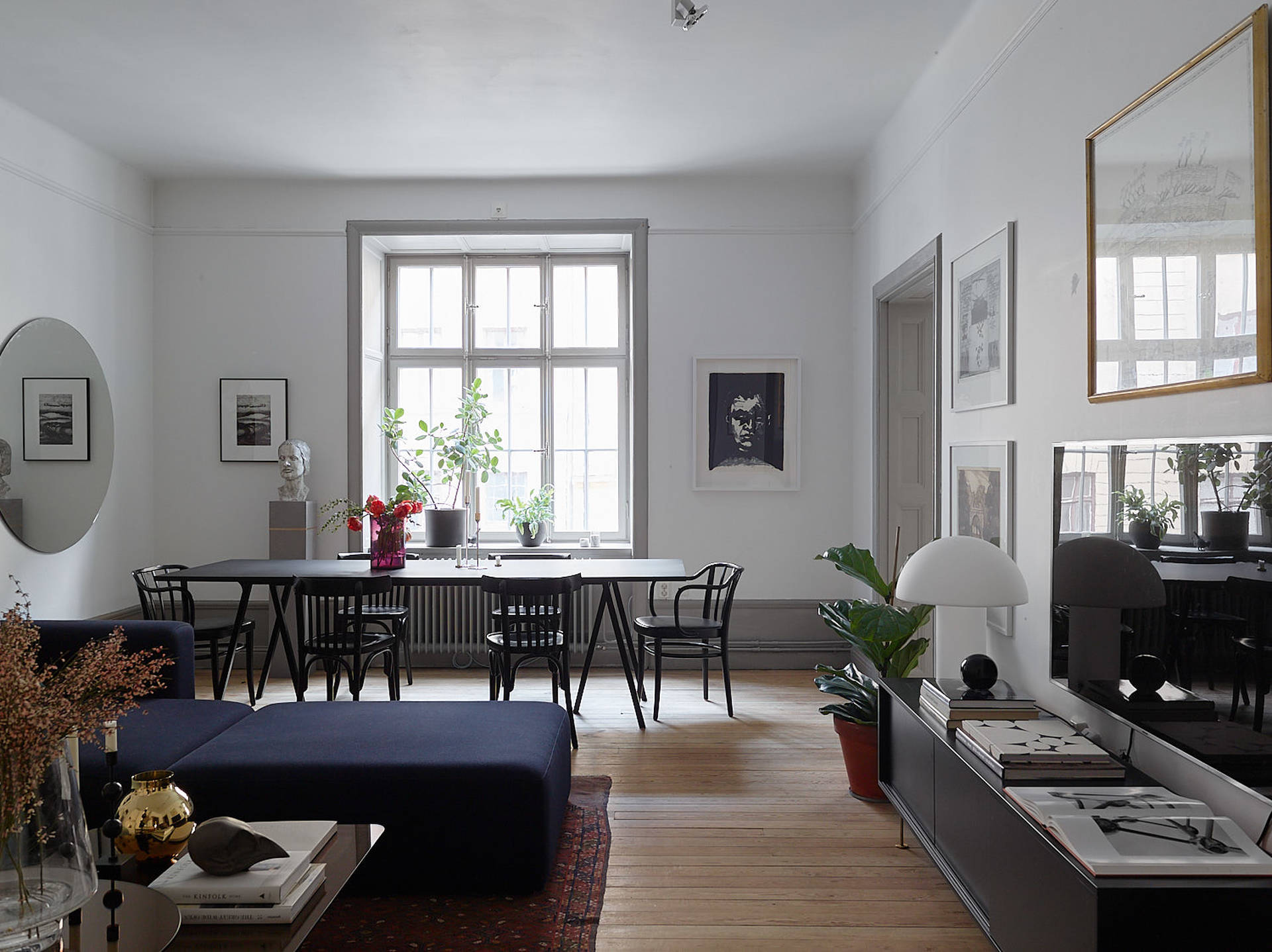 I like the look of this spacious turn of the century apartment with gorgeous architectural details the living room has enough space to include both a large