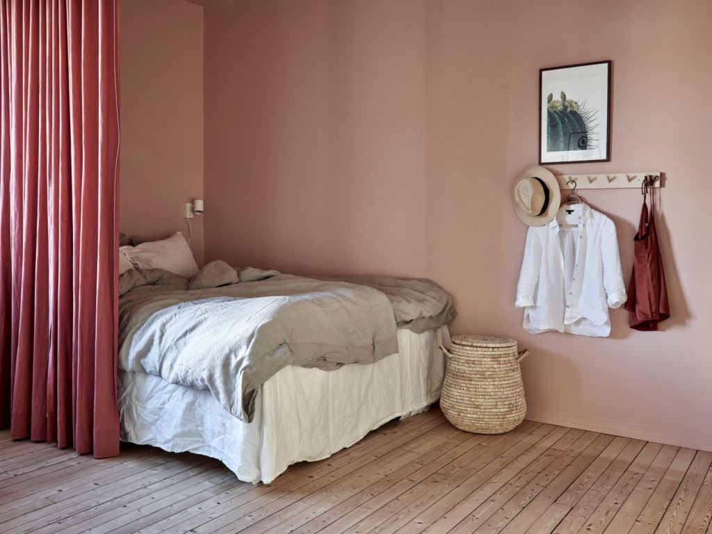 Pink bedroom behind a curtain