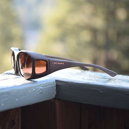 Cocoons fitover sunglasses with copper lenses