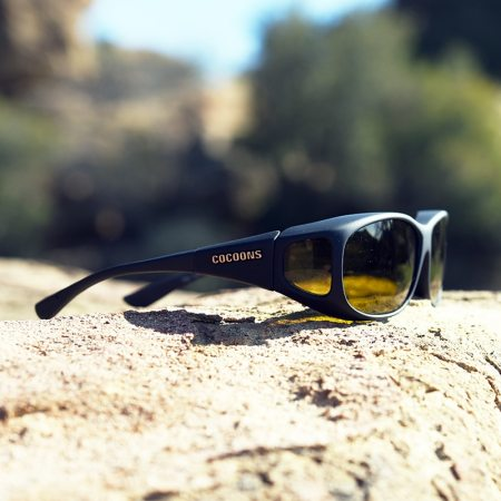 Fishing fitover sunglasses sitting on a rock