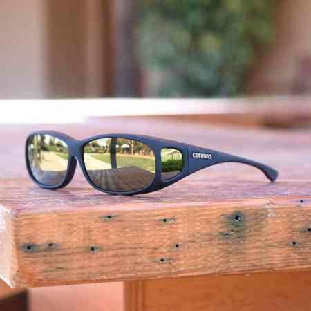 Wear Cocoons fitover sunglasses when skiing