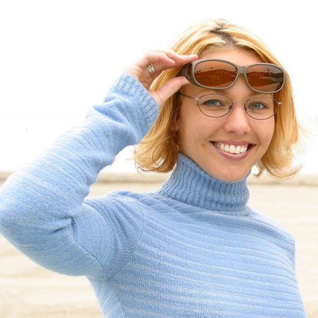 Womens fashionable fitover sunglasses on the beach