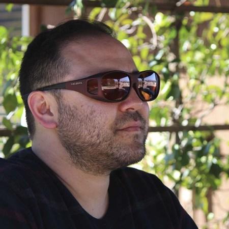 Contrast enhancing fitover sunglasses on daniel