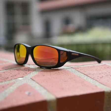 cocoons fitover sunglasses rose tinted lenses on bricks