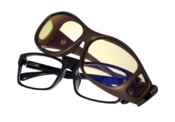 Cocoons Slim Line fitovers are a traditional rectangle frame designed to fit over many of today's eyewear frames and features an HEV blue light filter system