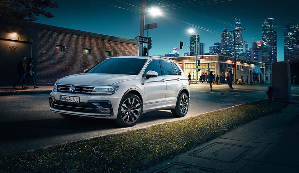 Looking for a family-sized car with plenty of room, full of style and drives really well? Look no further than the new VW Tiguan! The reviews have been fantastic about the 2016 specification and it's not hard to see why. This medium SUV comes with 5 doors and 5 seats, plenty of room for the family, the golf clubs or if you just like space, you'll find it hard not to love this revamped VW model. The stylish exterior means you'll stand out from the crowd and the interior is just as special. Take the dynamic roofline for instance; the optional panoramic glass sunroof fills the interior with light creating the illusion of a much bigger space whilst the new longer wheelbase (an extra 77mm) creates more legroom for rear-seat passengers. The back seats can also slide on runners by up to 170mm to release even more rear legroom or boot space. If boot space is your priority, you can drop the rear seats to revel in 1655 litres of square shaped load bay space! So what about the drive? The Tiguan has a selection of all-turbocharged engines, the petrol option provides 180bhp from its 2-litre engine or if you prefer a diesel car you'll be provided with 148bhp from its 2-litres. There's also the choice of 2 or 4-wheel drive. Whichever you choose you're in for a comfortable ride with the Tiguan, the light steering makes the drive around town a doddle yet it's easy to manoeuvre and grips confidently to the open road. If you're after the seven-speed dual clutch gearbox then you'll have to opt for the four-wheel drive option however, if it's fuel economy you're after then the six-speed manual with the 2-wheel drive will be the choice for you. There' no doubting that you'll be spoilt with the VW Tiguan, it certainly rivals the BMW X3 and the Volvo XC60. The chances are that these will be selling like hot cakes, and if you want a piece of the action why not get in touch today? We have great offers on the Tiguan and we're more than happy to talk through your leasing options with you. Give us a call on 01332 298173 or complete the form below and we will be in touch shortly.