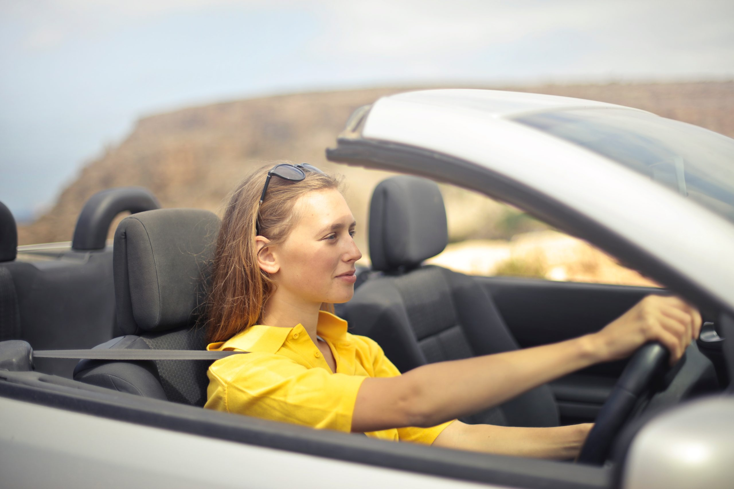 woman driving open top car