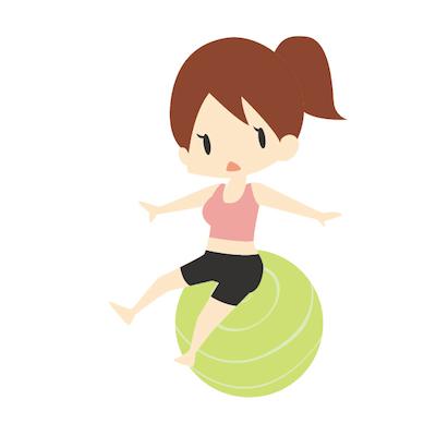 バランスボールに乗る女性