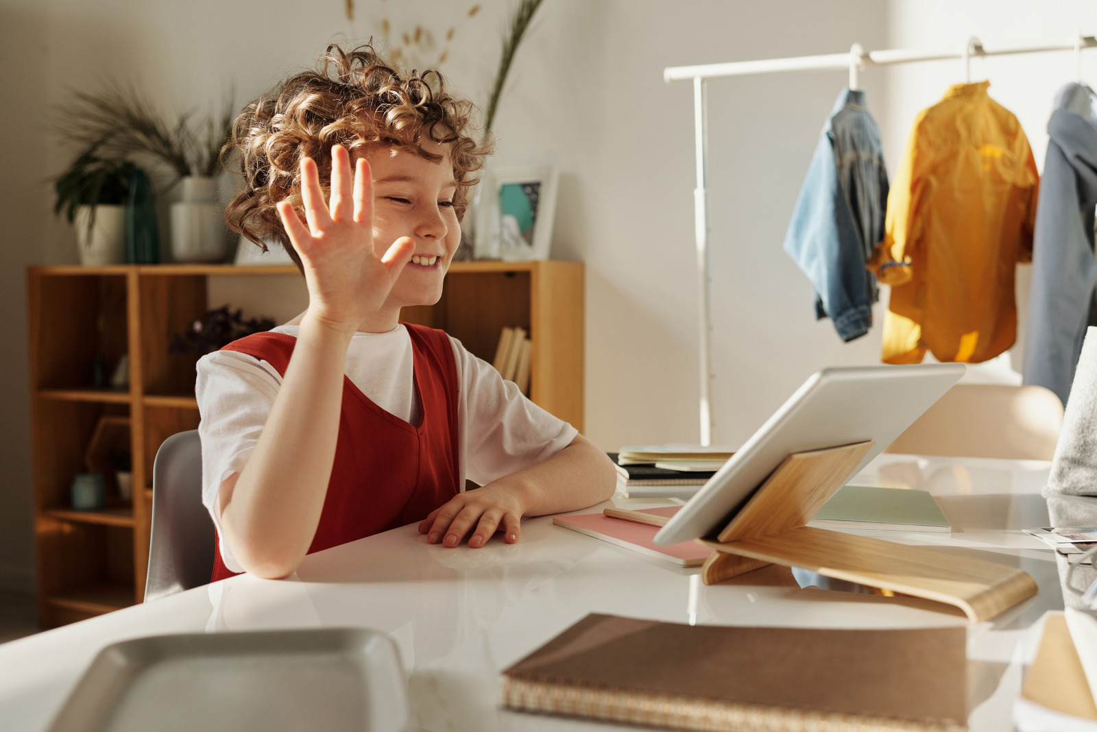 Canva Photo of Child Smiling While Using Tablet Computer 1