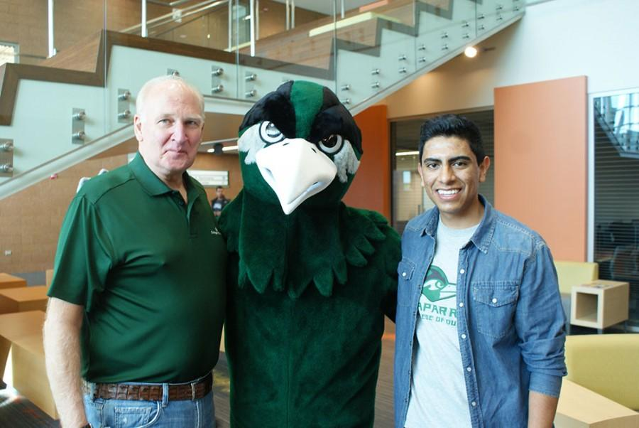 College of DuPage President Robert L. Breuder, left, poses with Chappy and student Trustee Omar Escamilla, right.
