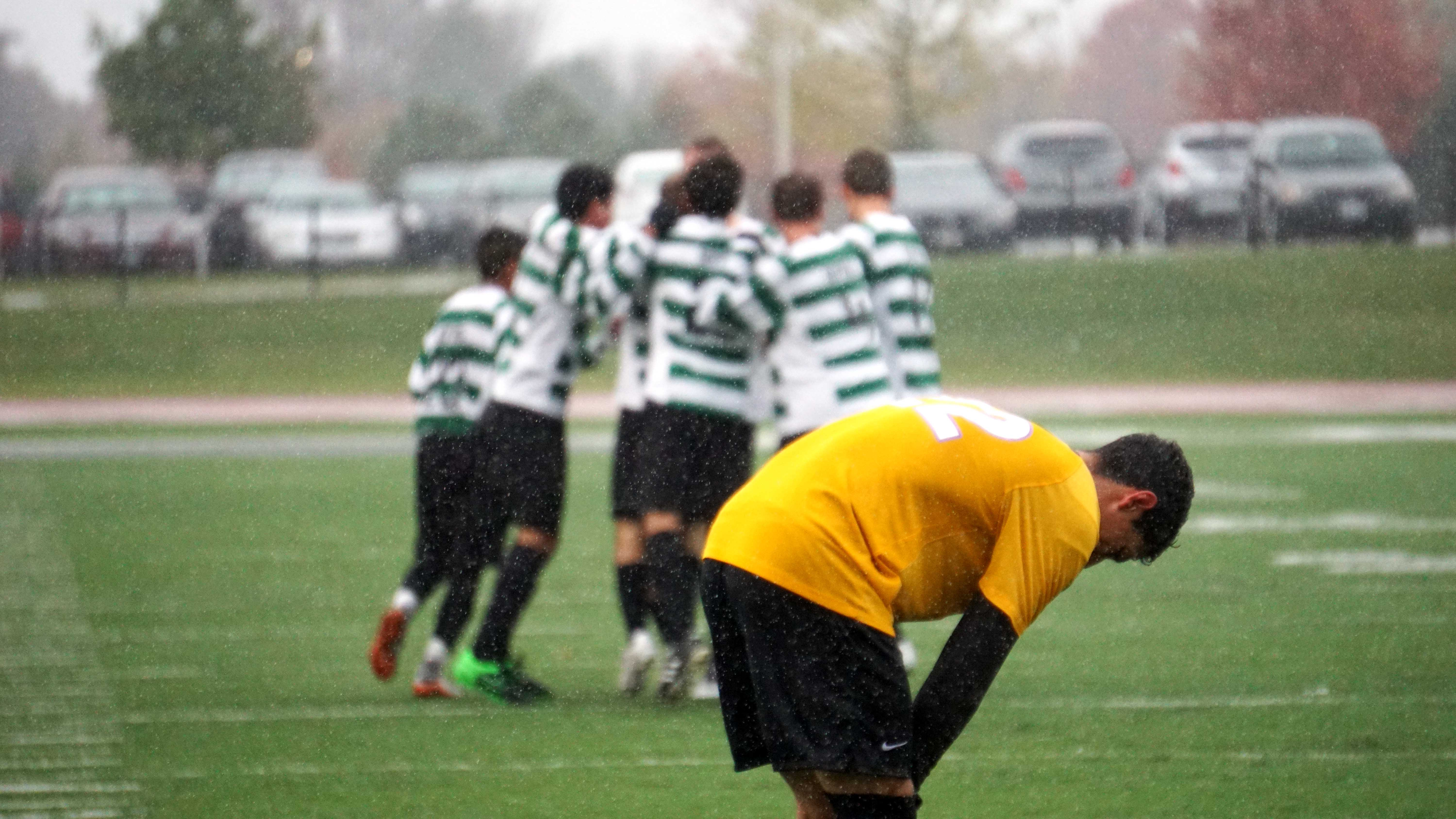A group of Chaparral players celebrate after a goal at a game against McHenry County College at the College of DuPage.