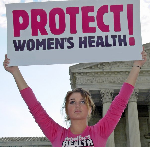A+woman+marching+for+women%27s+rights+during+a+recent+march+in+D.C.+