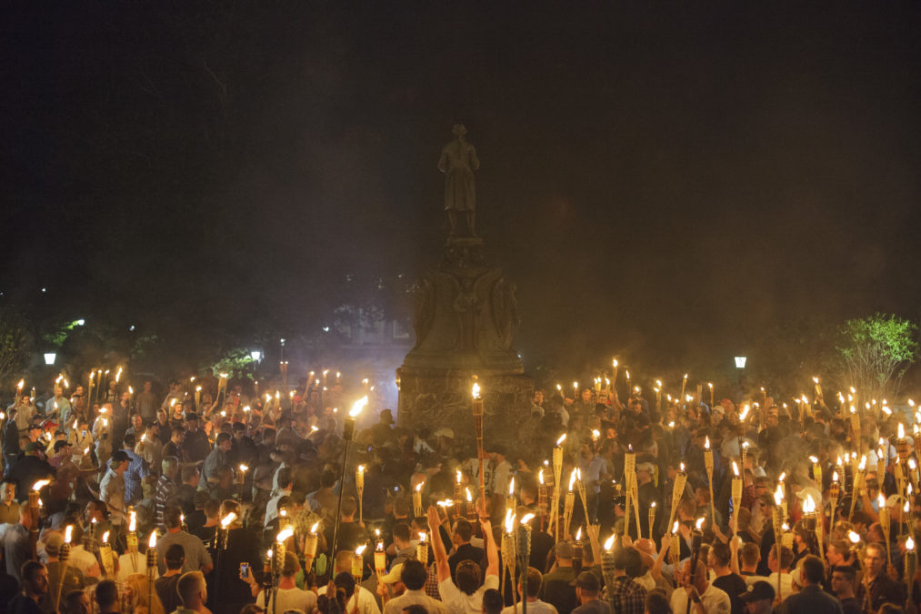 Neo Nazis, Alt-Right, and White Supremacists encircle counter protestors at the base of a statue of Thomas Jefferson after marching through the University of Virginia campus with torches in Charlottesville, Va., USA on August 11, 2017 (Photo by Shay Horse/NurPhoto)(Sipa via AP Images)