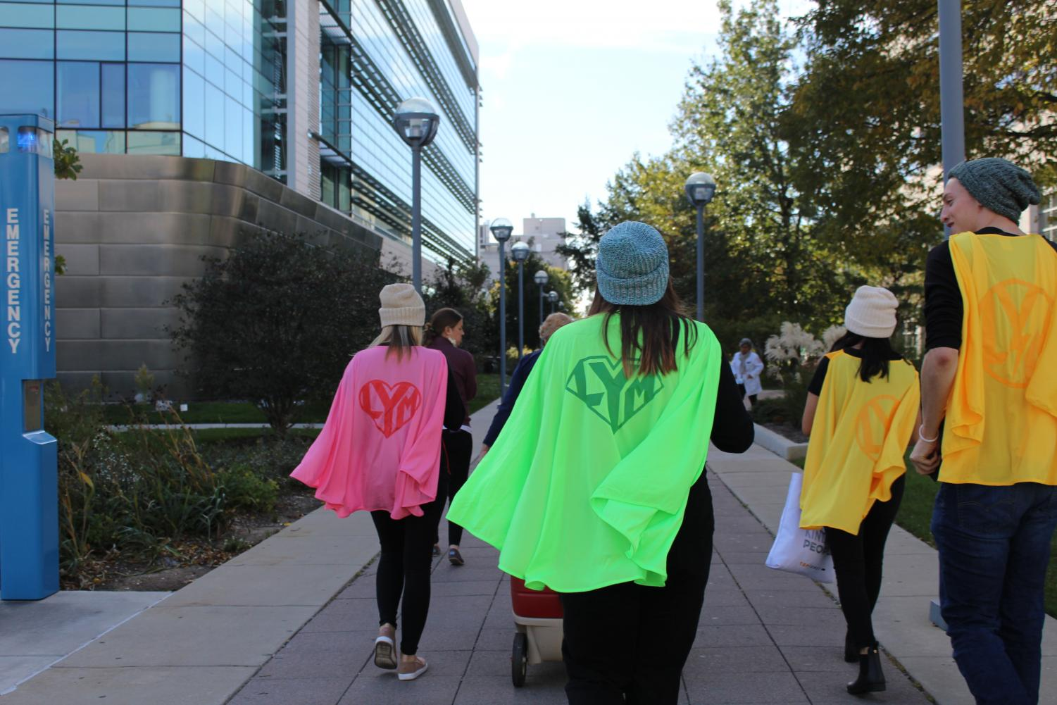 Club members visited Loyola Hospital dressed as superheroes, handing out beanies to children battling cancer.