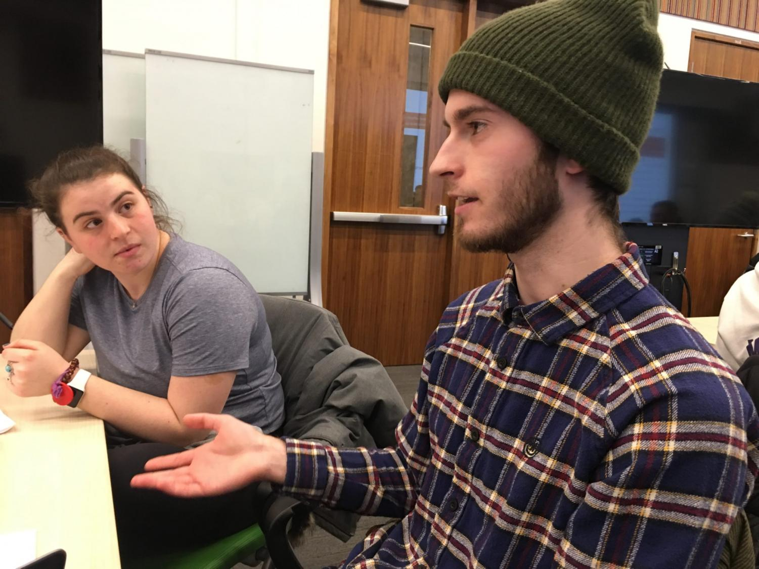 Julia Pascale, a sophomore from Baltimore, and Kyle Herbstreit, a junior from Stevensville, Michigan, discuss the death penalty during a session sponsored by WeListen, a bipartisan student group at the University of Michigan.