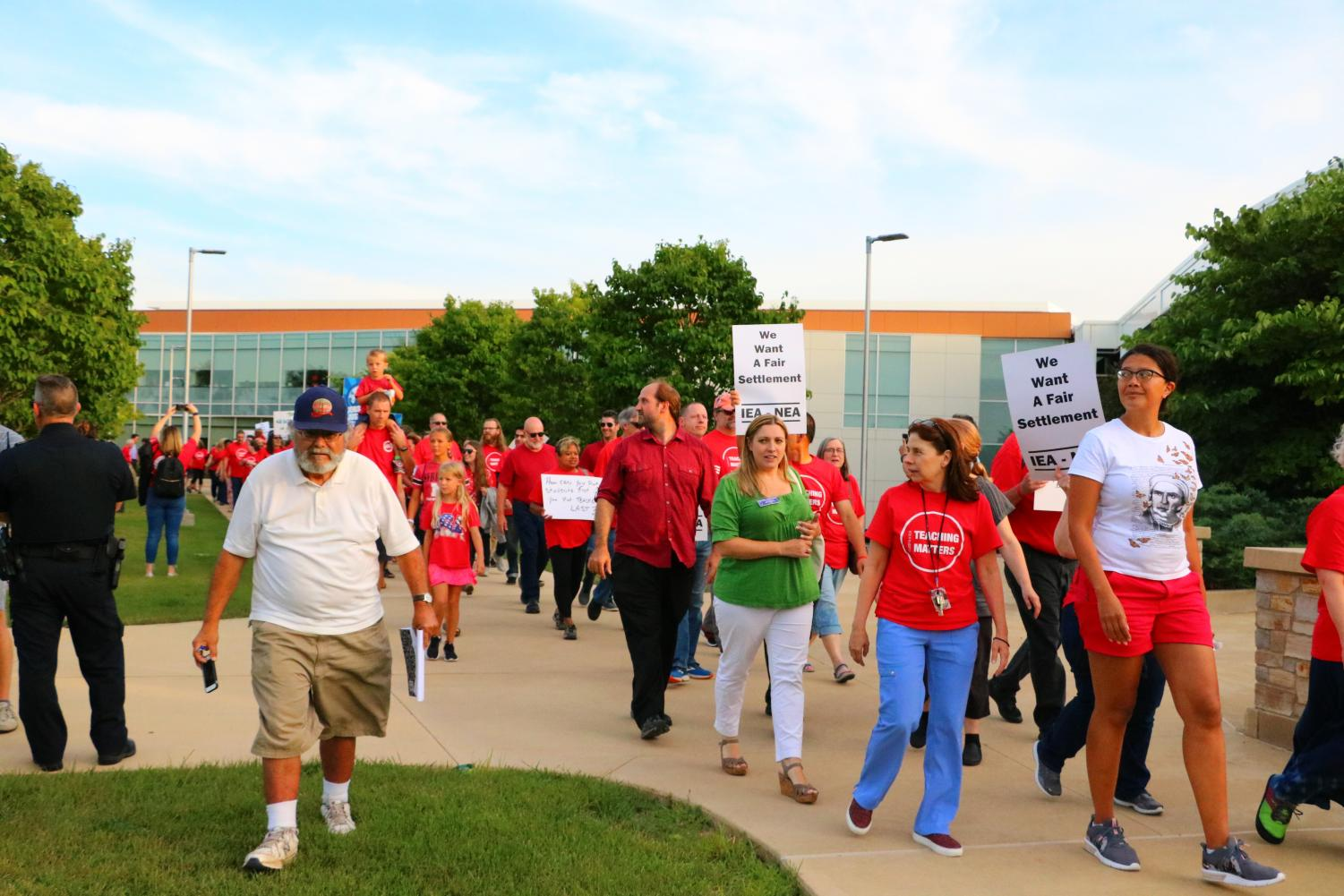 The College of DuPage Faculty Association and community supporters protest before the Aug. 15 board of trustees  meeting (photo by: Alison Pfaff)