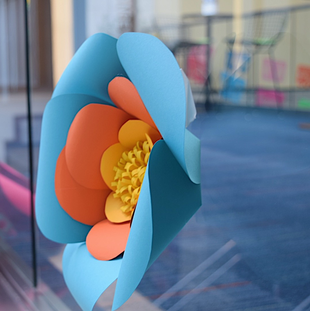Paper+flowers+were+displayed+throughout+the+event+to+symbolize+Frida+Kahlo.