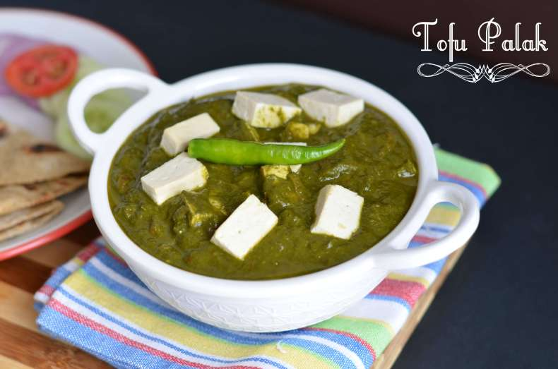 Tofu palak or tofu in spinach gravy is pan fried tofu, cooked in spinach puree with onion-tomato and garam masala. Garnished with fresh cream this lip-smacking tofu palak gravy is a great combination with nan or rice. You can never go wrong with this delicious dish.
