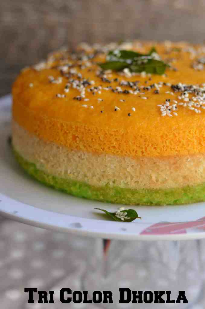 Tri-Color Dhokla is a popular Gujarati snack. It is a steamed & spongy snacktempered with mustard seeds and sesame seeds. This delightfultri-color dhokla is so simple to make. Since dhokla is steamed version so it is healthy as well. You can avoid oil tempering if you are weight conscious.