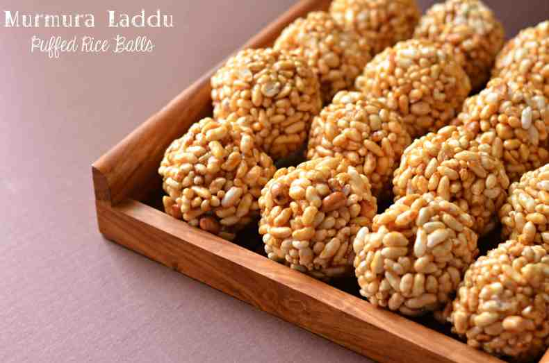 Murmura laddu served in wooden tray and clicked from right side.
