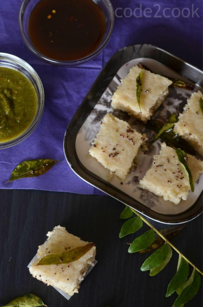 Oats dhokla is the instant dhokla recipe with oats flour, semolina and curd in equal portions, which is a savory and steamed snack or a great breakfast or a great meal in itself. Seasoned with mustard seeds, curry leaves and green chilies this oats dhokla is a perfect guilt-free food to consume.