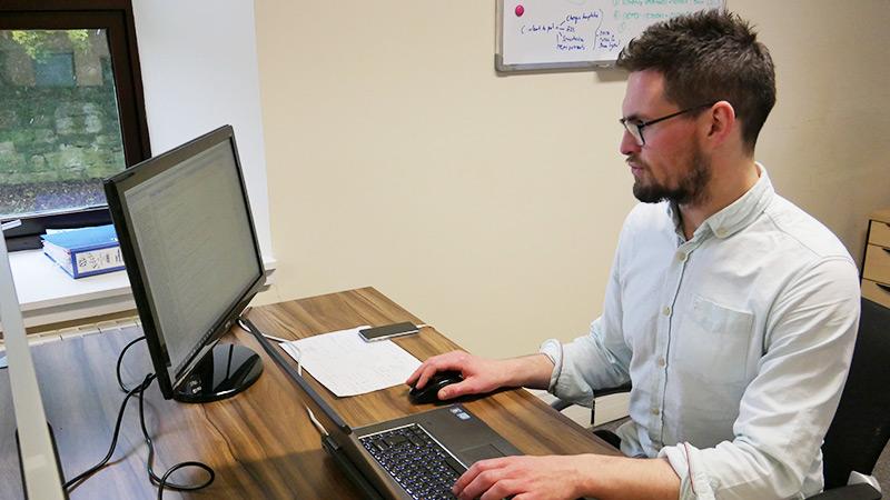 Alasdair working at his desk
