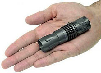 The Surefire M1 is an inexpensive high quality IR Illuminator that works well with most night vision devices.