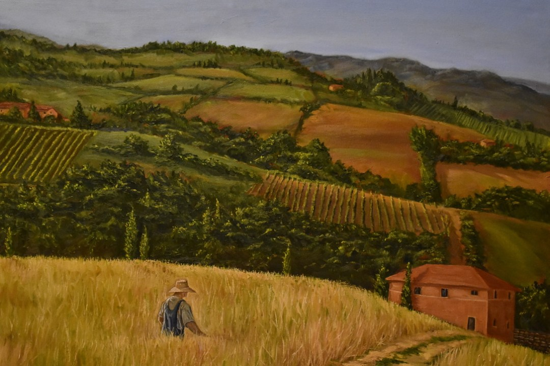Oil painting of farmer in the French countryside walking home across a meadow of tall grass by Cody Oldham